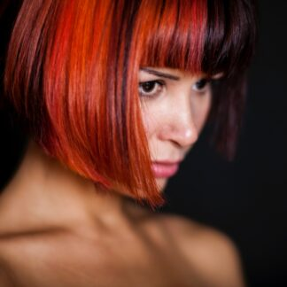 woman sporting a straight red bob hair cut with the best red hair dye you can do at home