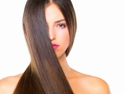 Amla naturally rejuvenates, cleanses and conditions hair; close up of young woman with straight , long, brown hair covering part of her face