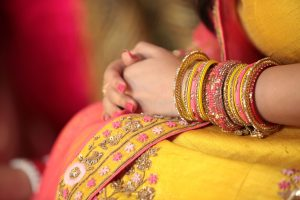 ethnic gift, photo of indian woman in yellow dress wearing colourful bangles