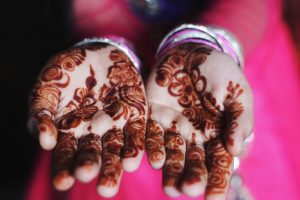 Organic henna from Rajasthan is known for it's strong henna dye and beautiful soft consistency; photo of hennaed hands