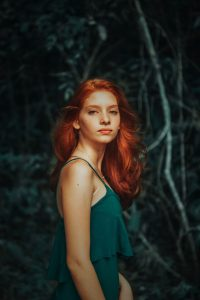 Permanent Red Hair Dye UK, Finest Ortganic BAQ Henna, woman with woman with long red hair in a slinky emerald green dress