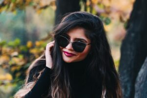 beautiful woman wearing sunglasses with long dark glossy hair coloured with organic dark brown hair dye chemical free hair colour 100% natural