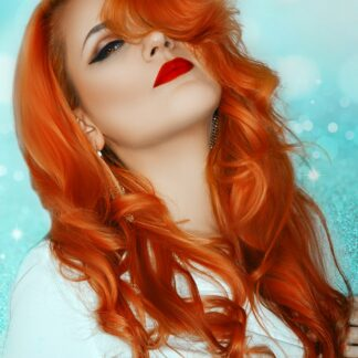 woman wearing short sleeve white dress with stunning long red hair colour