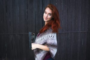 woman with long red hair wearing shawl and natural looking red hair dye