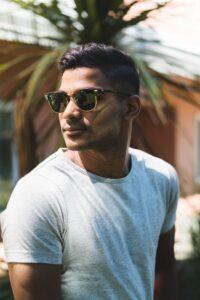 asian man in white T shirt and sun glasses with dark hair colour for men dark brown black