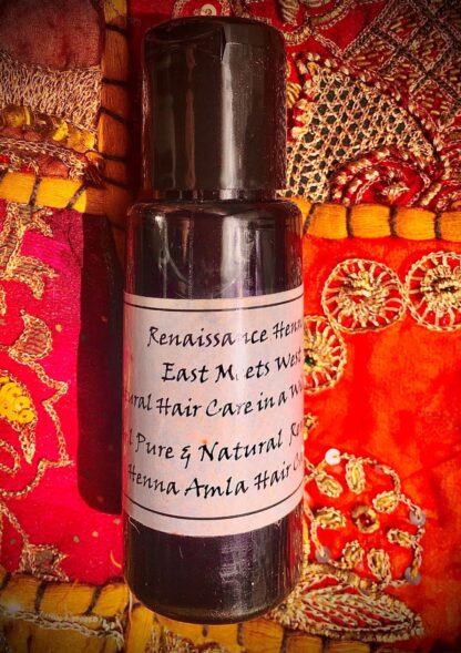bottle of Natural Men's hair & beard oil infused with neem & amla