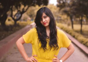 organic natural hair dye herbal hair colour lady with long brown hair wearing a yellow short sleeve dress