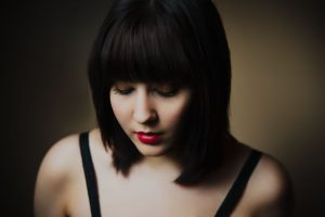 black hair on pretty young woman,with short bob hairstyle, looking down