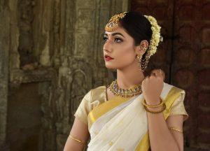 indigo tamil nadu, asian woman with beautiful black hair wearing cream and gold sari