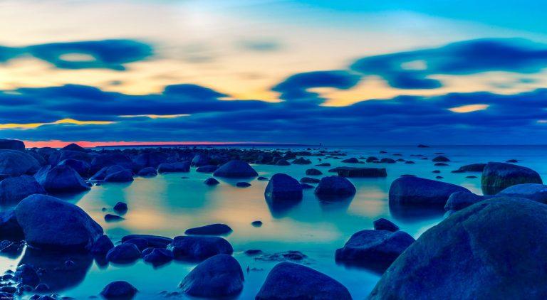 Indigo black hair dye, dark blue nature scene, lake in front of mountains