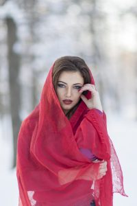 Compound henna has given pure henna a bad reputation; photo of sad young woman wearing red