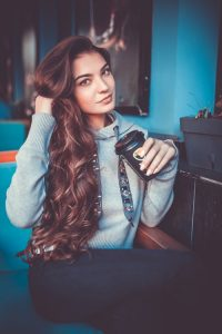 Bhringraj Hair Oil , beautiful young woman with veyr long brown , wavy, healthy, hair