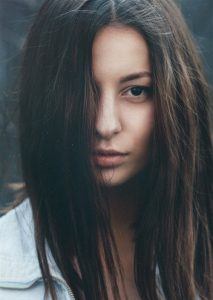 Brown hair, long straight hair, over girl's face
