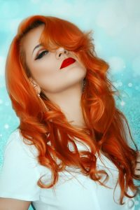 hair dyes after henna, photo of woman with long wavy auburn red dyed hair