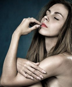 cassia obovata skin treatment and nail repair, beautiful woman with glowing bare skin and beautiful nails