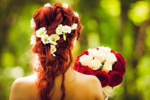 henna in beautiful long hair decorated with white flowers