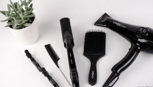 hair salon safety - read on for beauty parlour syndrome - could your salon shampoo put you at risk of a stroke? ; photo of black hair tools on a white counter next to a plant