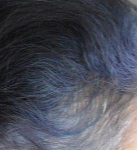 Purple hair colour fade as indigo fades in gray hair
